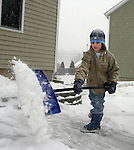 NAUGATUCK, CT. 31 DECEMBER 01_NEW_123108DA03.jpg- Ryan Dumschott, 9, of Naugatuck shovels his driveway during Wednesday winter storm.<br />  Darlene Douty