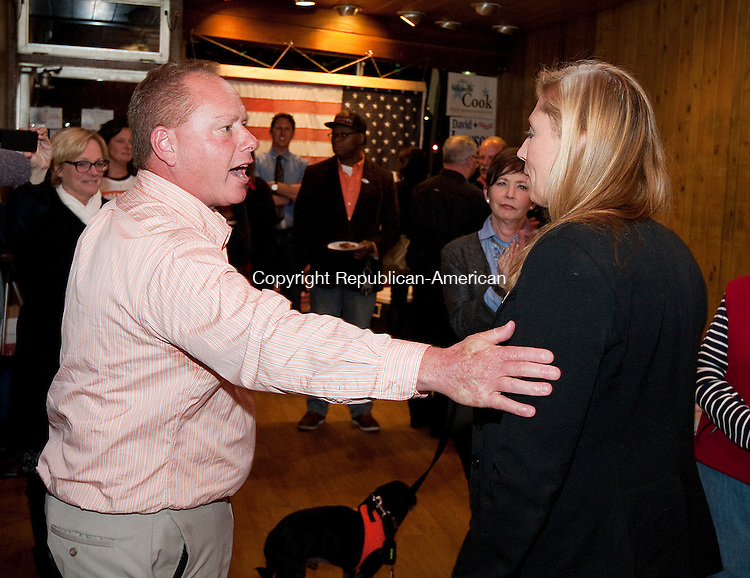 TORRINGTON,  CT-110816JS27- Republican challenger Todd Schaller , left, offers congratulations to incumbent Michelle Cook (R-Torrington) after she defeated him to retain the  65th House District seat Tuesday at Democratic Campaign Headquarters on Main Street in Torrington.  Jim Shannon Republican American