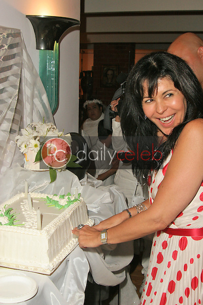 Maria Conchita Alonso cuts her birthday cake<br /> at Maria Conchita Alonso's Surprise Birthday Party, Private Residence, Los Angeles, CA 06-25-05<br /> David Edwards/DailyCeleb.Com 818-249-4998<br /> EXCLUSIVE