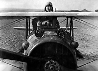 First Lieut.  E. V. (Eddie) Rickenbacker, 94th Aero Squadron, American ace, standing up in his Spad plane.  Near Rembercourt, France.  October 18, 1918.  Sgt. Gideon J. Eikleberry. (Army)<br />
