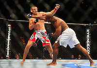 Oct. 29, 2011; Las Vegas, NV, USA; UFC fighter Clifford Starks (right) against Dustin Jacoby during a middleweight bout during UFC 137 at the Mandalay Bay event center. Mandatory Credit: Mark J. Rebilas-