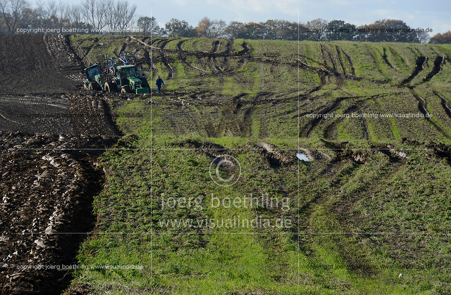 Germany, farming with extreme wet soil conditions after heavy rainfall for days, two big John Deere tractors deadlocked in the furrow / DEUTSCHLAND, Mecklenburg, extrem nasses Feld nach Starkregen, festgefahrener Traktor