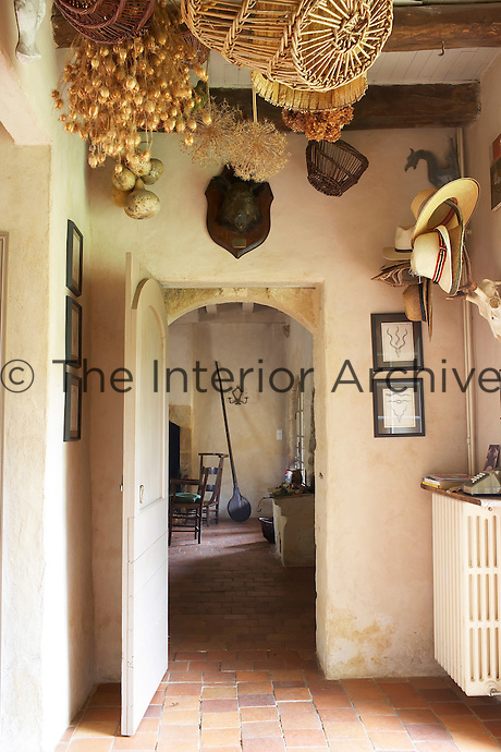 Looking through doorway to rustic kitchen/dining room, Chateau de la Bourlie, Dordogne