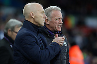 Swansea Citys head coach Bob Bradley and first team coach Alan Curtis during the Premier League match between Swansea City and West Ham United at The Liberty Stadium, Swansea, Wales, UK. Monday 26 December 2016