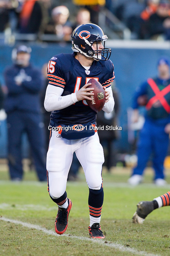 Chicago Bears quarterback Josh McCown (15) looks for a receiver during a week 15 NFL football game against the Seattle Seahawks on December 18, 2011 in Chicago. The Seahawks won 38-14. (AP Photo/David Stluka)