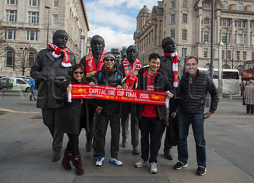 25.02.2016. Liverpool, England. UEFA Europa League game between Liverpool FC and Augsburg.  A Group of Liverpool supporters from Hong Kong pose before the Beatles Monument with Jurgen Klopp Masks