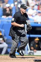 Umpire Mark Carlson during a spring training game between the Atlanta Braves and Detroit Tigers on February 28, 2014 at Joker Marchant Stadium in Lakeland, Florida.  Detroit defeated Atlanta 5-2.  (Mike Janes/Four Seam Images)