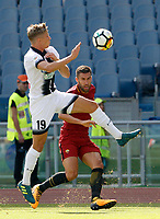 Calcio, Serie A: Roma vs Udinese. Roma, stadio Olimpico, 23 settembre 2017.<br /> Roma&rsquo;s Kevin Strootman, right, is challenged by Udinese&rsquo;s Jens Larsen during the Italian Serie A football match between Roma and Udinese at Rome's Olympic stadium, 23 September 2017. Roma won 3-1.<br /> UPDATE IMAGES PRESS/Riccardo De Luca