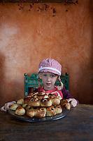 A little girl eagerly anticipating eating a plate of traditional Swedish Christmas bread