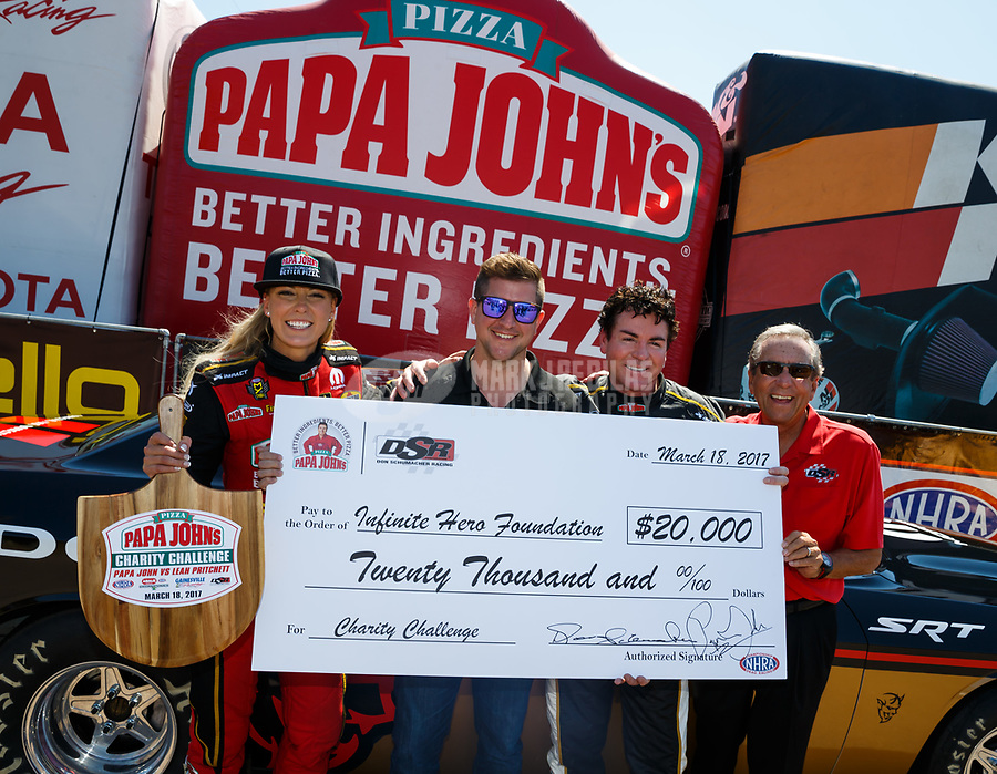 Mar 18, 2017; Gainesville , FL, USA; NHRA top fuel driver Leah Pritchett (left) with Papa Johns Pizza founder John Schnatter and team owner Don Schumacher during qualifying for the Gatornationals at Gainesville Raceway. Mandatory Credit: Mark J. Rebilas-USA TODAY Sports