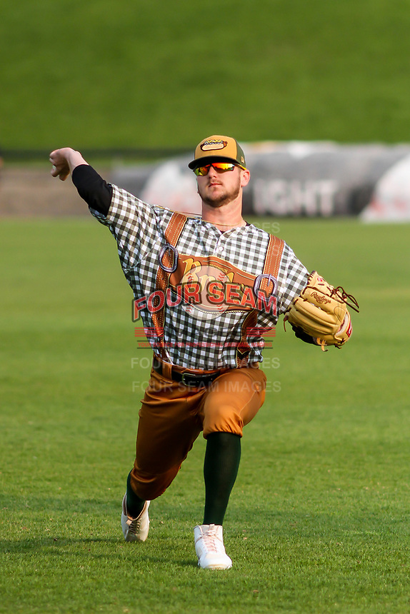 Wisconsin Timber Rattlers pitcher Logan Gillaspie (33) warms up in the outfield prior to a Midwest League game against the Peoria Chiefs on May 31, 2019 at Fox Cities Stadium in Appleton, Wisconsin. Peoria defeated Wisconsin 3-0. (Brad Krause/Four Seam Images)