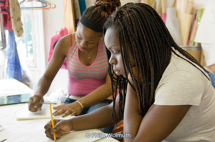 NWCS work experience pupils Francesca Wilson (R) and Chinwe-Ike (L) design T shirts while on placement at Flamboyan Carnival Arts.
