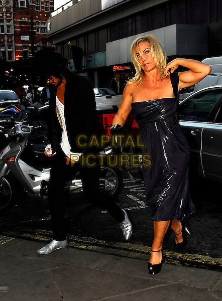 "MEG MATTHEWS & GUEST.Attends The Perfume Shop / LK High Street Fashion Awards, Cafe De Paris, 3 Coventry Street, London, England..May 14th 2007.full length purple dress one shoulder YSL Yves Saint Laurent peep-toe Mary Jane ""Tribute"" pumps platfoms ankle strap shoes black hat bag purse .CAP/IA.©Ian Allis/Capital Pictures"