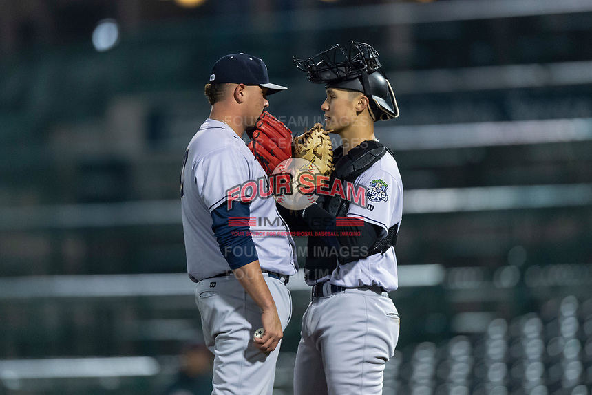 Kane County Cougars relief pitcher Chester Pimentel (40) and catcher Andy Yerzy (38) talk on the mound during a Midwest League game against the Fort Wayne TinCaps at Parkview Field on April 30, 2019 in Fort Wayne, Indiana. Kane County defeated Fort Wayne 7-4. (Zachary Lucy/Four Seam Images)