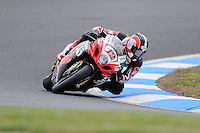 PHILLIP ISLAND, 22 FEBRUARY - Joshua Waters (AUS) riding the Suzuki GSX-R1000 (12) of the YOSHIMURA SUZUKI Racing Team at day two of the testing session prior to round one of the 2011 FIM Superbike World Championship at Phillip Island, Australia. (Photo Sydney Low / syd-low.com)
