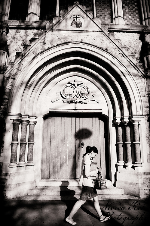 Woman walking past church in Crystal Palace, South London