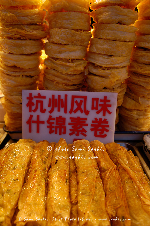 Sign on piles of food at Wangfujing night market, Beijing, China.