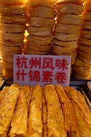 Sign on piles of food at Wangfujing night market, Beijing, China.