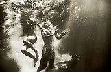 USA, California, Forks of Salmon, man and women swimming underwater in the Salmon River, Otter Bar Kayaking School (B&W)