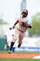 Mississippi Braves shortstop Elmer Reyes (14) runs the bases during a game against the Montgomery Biscuits on April 22, 2014 at Riverwalk Stadium in Montgomery, Alabama.  Mississippi defeated Montgomery 6-2.  (Mike Janes/Four Seam Images)