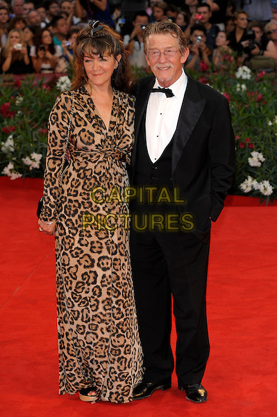 Anwen Rees Meyers & John Hurt.The 'Tinker, Tailor, Soldier, Spy' premiere at the Palazzo del Cinema during the 68th Venice Film Festival, Venice, Italy..September 5th, 2011.full length black tuxedo leopard print brown dress married husband wife .CAP/PL.©Phil Loftus/Capital Pictures.
