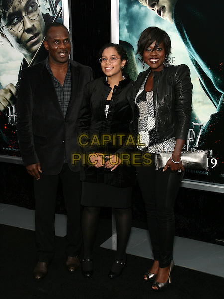 """VIOLA DAVIS & family.The New York Premiere of """"Harry Potter and the Deathly Hallows Part I"""" held at Alice Tully Hall - Lincoln Center, New York, NY, USA..full length black jacket clutch bag silver top leggings shoe grey gray peep toe platform leather shoulder pads.CAP/LNC/TOM.©TOM/LNC/Capital Pictures."""
