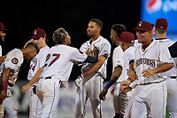 Mahoning Valley Scrappers Michael Cooper (center) is mobbed by teammates, including Pedro Alfonseca (27), after hitting a walk off single during a NY-Penn League game against the Hudson Valley Renegades on July 15, 2019 at Eastwood Field in Niles, Ohio.  Mahoning Valley defeated Hudson Valley 6-5.  (Mike Janes/Four Seam Images)