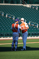 Catcher Raul Aragon (4) of Paschal High School in Fort Worth, Texas talks with pitcher Colton Bowman (13) of Bullard High School in Bullard, Texas during the Baseball Factory All-America Pre-Season Tournament, powered by Under Armour, on January 13, 2018 at Sloan Park Complex in Mesa, Arizona.  (Zachary Lucy/Four Seam Images)