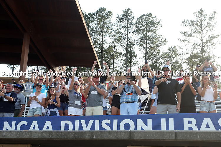 04 June 2016: Nova Southeastern fans applaud their team. The Nova Southeastern University Sharks played the Millersville University Marauders in Game 14 of the 2016 NCAA Division II College World Series  at Coleman Field at the USA Baseball National Training Complex in Cary, North Carolina. Nova Southeastern won the game 8-6 and clinched the NCAA Division II Baseball Championship.