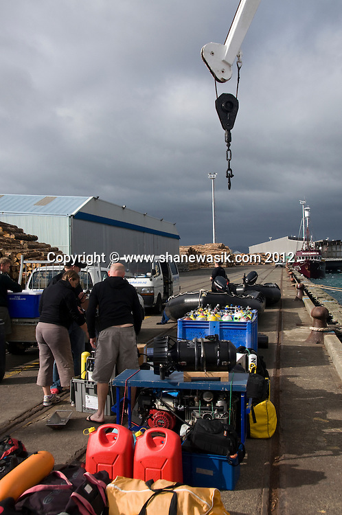 Loading diving equipment aboard expedition vessel, Spirit of Enderby at Mount Maunganui Wharf.