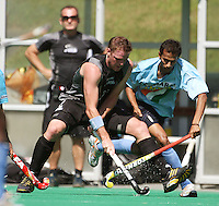 NZ's Bradley Shaw keeps the ball from SV Sunil during the international hockey match between the New Zealand Black Sticks and India at National Hockey Stadium, Wellington, New Zealand on Saturday, 20 February 2009. Photo: Dave Lintott / lintottphoto.co.nz