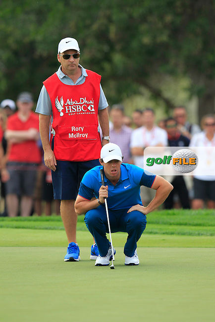 Rory McIlroy (NIR) lines up his putt on the 17th green during Sunday's Final Round of the Abu Dhabi HSBC Golf Championship 2015 held at the Abu Dhabi Golf Course, United Arab Emirates. 18th January 2015.<br /> Picture: Eoin Clarke www.golffile.ie