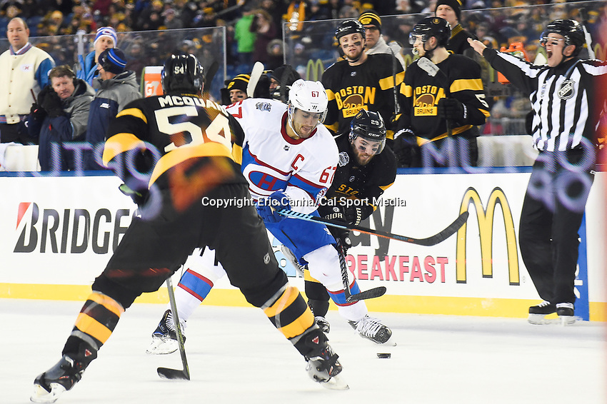 Friday January 1, 2016: Boston Bruins center Landon Ferraro (29) moves the puck over the blue line with Montreal Canadiens left wing Max Pacioretty (67) defending the zone  during the National Hockey League Bridgestone Winter Classic game between the Montreal Canadiens and the Boston Bruins, held at Gillette Stadium in Foxborough, Massachusetts. Montreal defeats Boston 5-1 in regulation time. Eric Canha/CSM