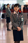 Apr. 12, 2010 - Tokyo, Japan - A ground staff employee is pictured at Tokyo's Haneda airport on April 12, 2010. Japan Airlines (JAL) and All Nippon Airways uniforms are now incredibly popular among fans with a uniform fetish and can command exorbitant prices on on-line auction sites.