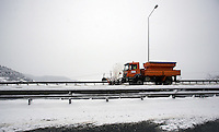 Pictured: A snow plough clears snow near the tolls of Metsovo in northern Greece Thursday 12 January 2017<br /> Re: Heavy snow has affected most parts of Greece.