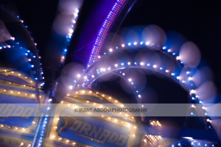 "A photography technique called ""focus blur"" is used to transform the lights of a carnival ride into abstract designs at the Montgomery County Agricultural Fair in Gaithersburg, Maryland."