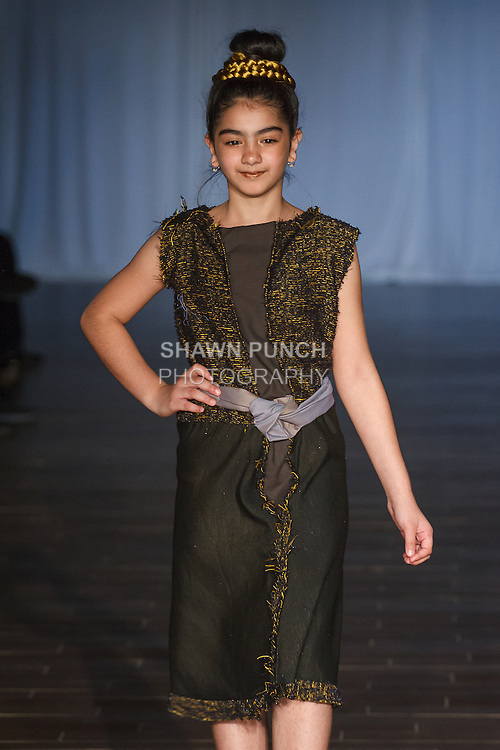 Model walks runway in an outfit from the Yadestiny Treasure Chest Spring Summer 2017 collection for Fashion Week Brooklyn Spring Summer 2017, on October 7th 2016 at Brooklyn Expo Center.