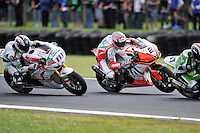 PHILLIP ISLAND, 27 FEBRUARY - Ruben Xaus (ESP) riding the Honda CBR1000RR (111) of the Castrol Honda Team and Leon Camier (GBR) riding the Aprilia RSV4 (2) of the Aprilia Alitalia Racing Team chase Bryan Staring (AUS) riding the Kawasaki ZX-10R (67) of the Team Pedercini during race one of round one of the 2011 FIM Superbike World Championship at Phillip Island, Australia. (Photo Sydney Low / syd-low.com)