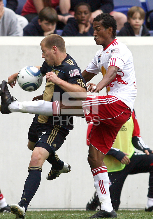 Jordan Harvey #2 of the Philadelphia Union tangles with Roy Miller #7 of the New York RedBulls during a MLS  match on April 24 2010, at RedBull Arena, in Harrison, New Jersey.