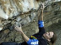 Professional rock climber Timmy Fairfield (CQ) climbs at a bouldering location named Sheng Dian in Las Huertas Canyon, Monday, Oct. 18, 2004...PHOTOS/ MATT NAGER