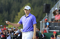 Matthew Fitzpatrick (ENG) sinks his birdie putt on the 18th green to tie the lead during Sunday's Final Round 4 of the 2018 Omega European Masters, held at the Golf Club Crans-Sur-Sierre, Crans Montana, Switzerland. 9th September 2018.<br /> Picture: Eoin Clarke | Golffile<br /> <br /> <br /> All photos usage must carry mandatory copyright credit (© Golffile | Eoin Clarke)