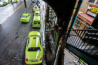 Astoria New York - 7 April 2016 Green Boro taxi cabs wait beneath the stairs of an elevate subway station in Astoria Queens, NewYork. ©Stacy Walsh Rosenstock