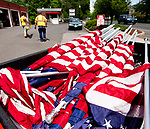 SOUTHBURY,  CT-052019JS01- Outside Properties workers for the Town of Southbury's Department of Public Works Nick Brennan and Jack Battaglia, were busy Monday putting up American flags on both sides of Main Street in Southbury as the town prepares for the upcoming Memorial Day weekend. <br /> Jim Shannon Republican American