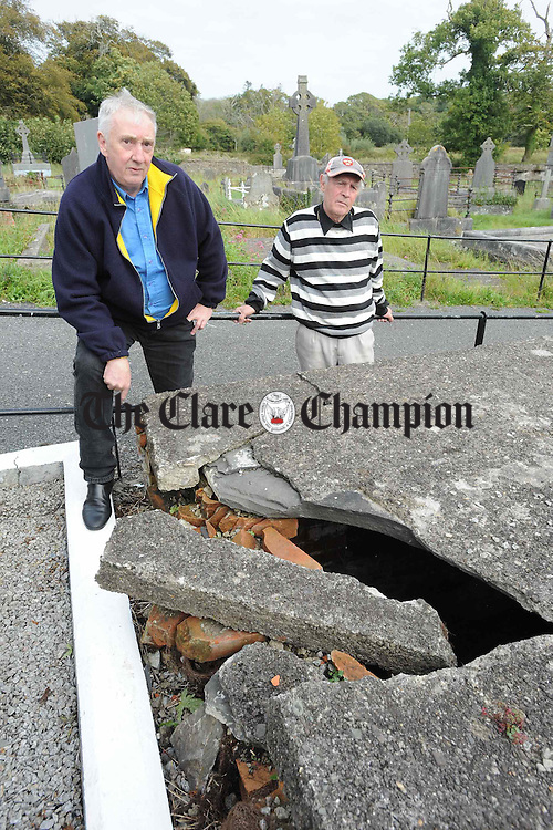 Tommy Scully and Sean Danaher, local volunteer workers, who are concerned over the dangers to children in the Old Protestant Graveyard at Grace street, Kilrush. Photograph by John Kelly.