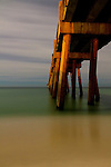 A long exposure of the Pensacola Beach fishing pier by moonlight.