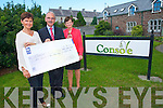 Julie Gaffey and Ann Wrenn, Killarney, present a cheque to Console founder, Paul Kelly, to further his group's work in suicide prevention and bereavement counselling from their base in Balloonagh, Tralee. Julie raised over €600 through asking for donations to Console instead of gifts at her 60th birthday party.