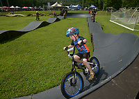 NWA Democrat-Gazette/BEN GOFF @NWABENGOFF<br /> Shane Oliver, 4, of Fort Smith rides the pump track in the 'kids skills course' Sunday, July 16, 2017, during the final day of the 19th annual Fat Tire Festival at Lake Leatherwood City Park in Eureka Springs.