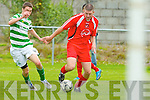 Peter McCarthy Tralee Dynamos cuts in the Rovers box with Donal Brannigan Shamrock Rovers in pursuit in Tralee on Sunday..