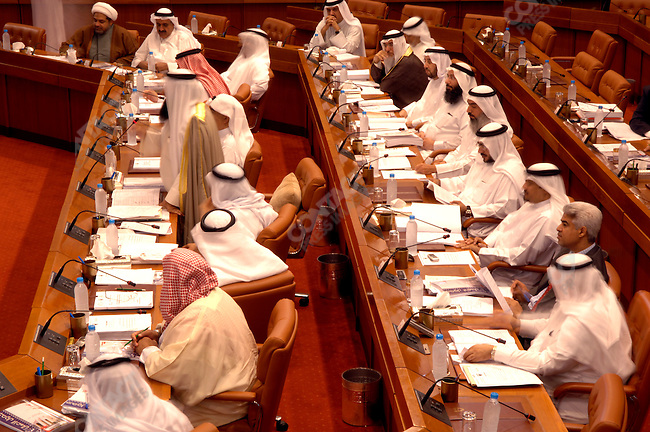 Deputies, including Jassim H. Abdul-Aal (wearing a suit bottom right) sat during a session of the Bahraini parliament, the lower house of the legislative body which is elected, Bahrain, December 12, 2005.