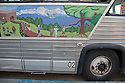 A close up of a painting on a side of Common Vision's bus. The vehicle runs on 100% recycled vegetable oil. San Francisco, California, USA